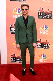 Adam Lambert suited up in this green Kris Can Assche number for the iHeartRadio Music Awards.