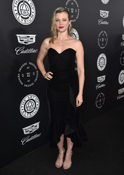 Amy Smart was classic in a strapless black velvet dress with a sweetheart neckline and a ruffle hem at the Art of Elysium Heaven Gala.