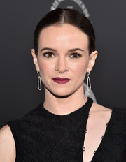 Danielle Panabaker went for a simple center-parted ponytail when she attended the Art of Elysium Heaven Gala.