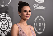 Victoria Justice styled her hair into a top knot for the Art of Elysium Heaven Gala.