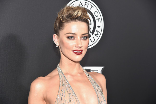 Amber Heard rocked a cool pompadour at the Art of Elysium Heaven Gala.