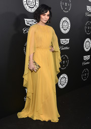 Vanessa Hudgens' textured gold Emm Kuo clutch was the perfect finishing touch to her lovely dress.