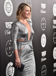 Ali Larter teamed a black Tyler Ellis envelope clutch with a jaw-dropping silver cutout dress for the Art of Elysium Heaven Gala.