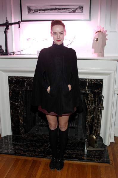 Jena Malone bundled up in a black cape for the Art of Elysium Heaven pre-event dinner.
