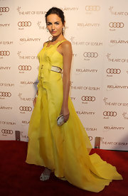 Camilla Belle topped off her yellow gown with evening sandals.