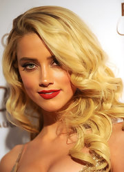 Amber Heard wore her hair in long shiny curls at the Art of Elysium's 5th Annual Heaven Gala.