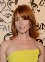 Alicia Witt's red locks bounced with this medium layered cut with bangs at the Pieces of Heaven event in LA.