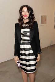 Abigail Spencer stuck to classic black and white with a bold striped dress and tailored blazer.