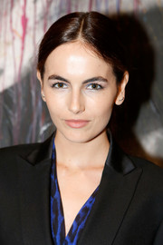 Camilla Belle kept it low-key with this center-parted ponytail at the Art of Elysium's Pieces of Heaven event.