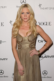 Actress Brittany Snow attended the 2011 Art of Elysium Heaven Gala wearing a variety of 18-karat gold Rock Candy and Glamazon bangles.