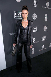 Bella Hadid styled her look with a cylindrical silver purse by Les Petits Joueurs.