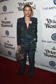 Dree Hemingway rocked an oversized, button-embellished green pantsuit at the Heaven Gala.