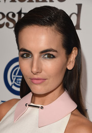 Camilla Belle contrasted her bold eye makeup with a soft pink lip.