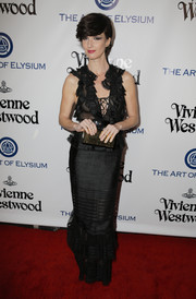 Paz Vega donned a black ruffle gown with a lace-up neckline for her Heaven Gala look.