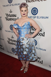 Kelly Osbourne risked a wardrobe malfunction in a very low-cut blue and silver strapless dress by Vivienne Westwood at the Heaven Gala.