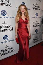 Amber Heard was equal parts sultry and sophisticated in a red satin cowl-neck gown by Vivienne Westwood Red Label at the Heaven Gala.