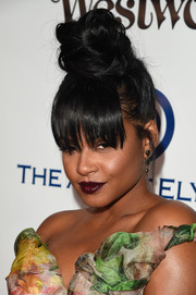 Christina Milian grabbed attention with her sky-high top knot at the Heaven Gala.