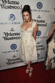 Charli XCX complemented her dress with a pair of white satin platform sandals.