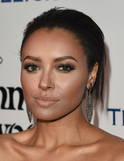 Kat Graham accentuated her eyes with a heavy application of brown shadow.