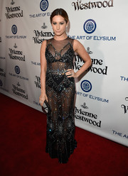 Ashley Tisdale was sexy and sparkly in a beaded, sheer gown by Davidson Zanine at the Heaven Gala.
