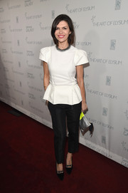 Finola Hughes was classic and demure in a white peplum top with cap sleeves.
