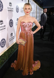 A Charlotte Olympia perspex box clutch with a gold pouch completed Kristen Bell's ensemble.