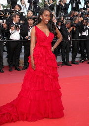 Aja Naomi King looked sweet and glam in a red Pamella Roland gown with a tiered, ruffled skirt at the Cannes Film Festival screening of 'Ash is the Purest White.'