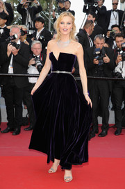 Eva Herzigova looked downright elegant in a strapless purple velvet gown by Dior Couture at the Cannes Film Festival screening of 'Ash is the Purest White.'