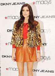 Ashley Greene topped off her cute ensemble with this faux fur leopard print jacket.
