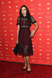 Famke Janssen looked very feminine in a red and black lace midi dress by Self-Portrait at the New York screening of 'The Assassination of Gianni Versace: American Crime Story.'