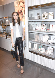 Louise Roe teamed a long gray vest with a white tee and black leather pants for a cool and casual look during the Atelier Swarovski awards season celebration.