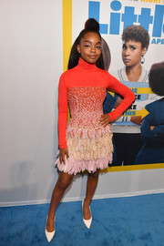 Marsai Martin attended the Atlanta screening of 'Little' wearing a multicolored fringe dress over a red turtleneck.