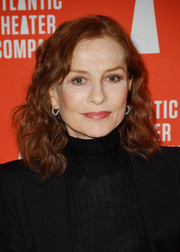 Isabelle Huppert went for classic styling with a pair of diamond hoops.
