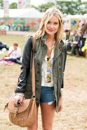 Laura Whitmore toted around her belongings in a leather messenger bag at the Glastonbury Festival in England.