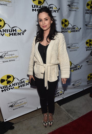 Eliza Dushku teamed her cardigan with a pair of skintight pants.