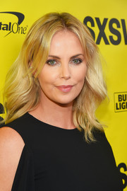 Charlize Theron looked lovely with her feathery waves at the SXSW premiere of 'Atomic Blonde.'