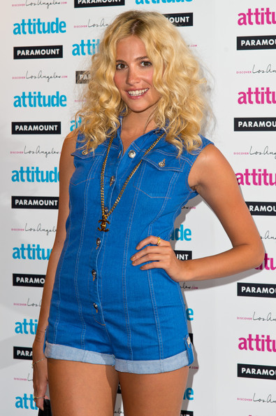 Pixie Lott attended the Attitude Magazine Hot 100 party wearing a Chanel gold chain necklace with a skimpy denim romper.