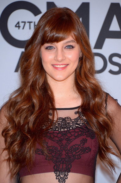 Aubrey Peeples Long Wavy Cut with Bangs [hair,beauty,human hair color,hairstyle,fashion model,long hair,shoulder,layered hair,bangs,hair coloring,cma awards,bridgestone arena,nashville,tennessee,arrivals,aubrey peeples]
