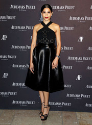 Freida Pinto rounded out her ensemble with black spiderweb platform sandals by Charlotte Olympia.
