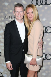 Cat Deeley added shimmer to ensemble with a metallic silver envelope clutch when she attended the Emmy kickoff party.