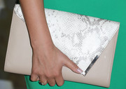 Courtney Galiano carried an ultra-chic nude leather clutch with a snakeskin flap when she attended the Emmy kickoff party.