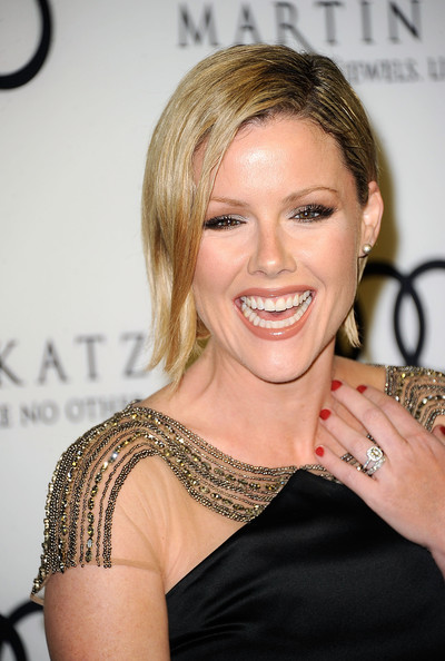 Kathleen Robertson paired a classic red nail polish with her black beaded dress at the 2012 Golden Globe Awards celebration.