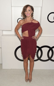 Karina Smirnoff put her super-fit body on display in a burgundy one-shoulder cutout dress during Audi's celebration of Emmys week.