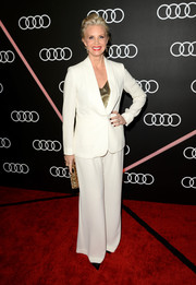 Monica Potter attended the Golden Globes Weekend celebration wearing a simple white pantsuit.