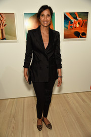 Padma Lakshmi opted for a simple ensemble, consisting of a black double-breasted blazer and skinny pants, when she attended Audi's celebration of its partnership with the Whitney Museum.