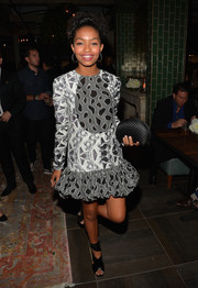 Yara Shahidi sealed off her look with a woven satin clutch by Ted Baker.