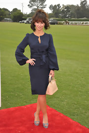 Jennifer Love Hewitt gave her demure navy dress a sultry finish with a pair of towering gray python platform peep-toes at the Foundation Polo Challenge.