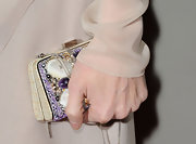 Paz Vega carried an intricate hard case clutch with purple beading.