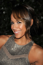 Dania Ramirez wore a loose bun that was fastened at the nape of the neck. Side swept wispy bangs completed her elegant look.