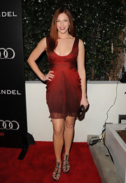 Amanda Righetti added serious sparkle to her sultry cocktail dress with strappy sandals adorned with Swarovski crystals.